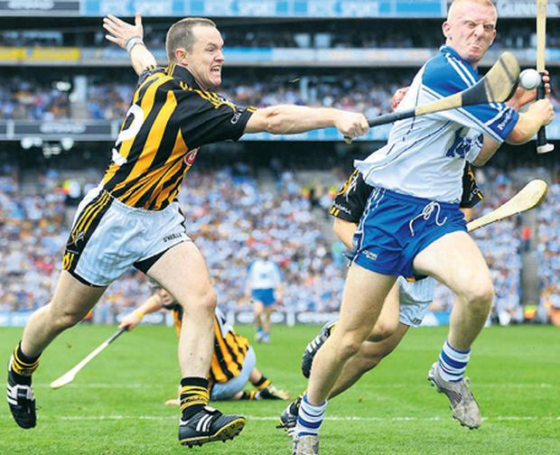 John Mullane is dispossessed with the deftest of touches from Michael Kavanagh as Kilkenny smother the Waterford attack in yesterday's one-sided All-Ireland SHC final at Croke Park.