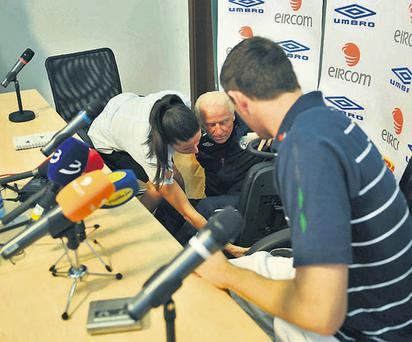 Republic of Ireland manager Giovanni Trapattoni falls off his chair before the start of yesterday's press conference in Podgorica, Montenegro
