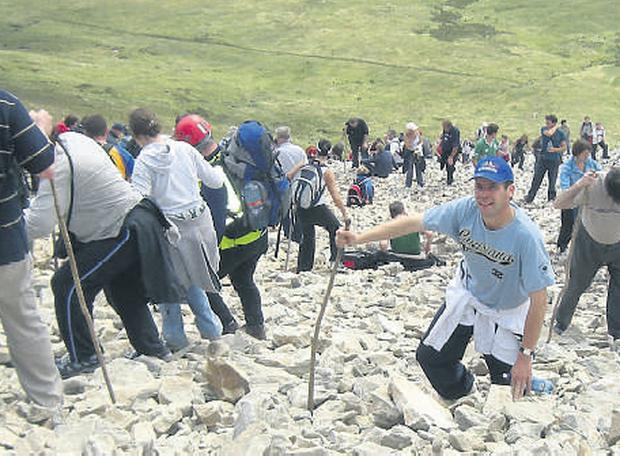 Pilgrimage: Climbing Croagh Patrick is modern religion in action, but how many participants are devoutly religious?