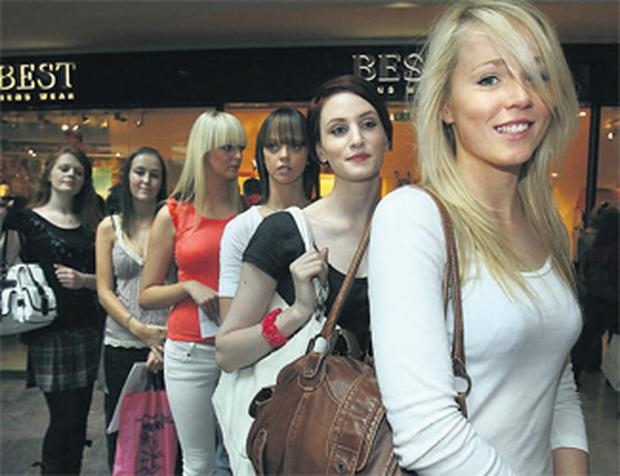 BEAUTIES: Kate McDaid leads the queue in Dundrum to try out for the series