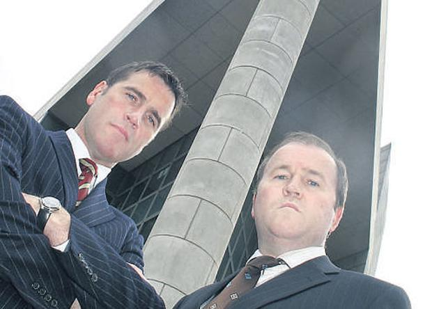 Michael Taggart, left, chief executive, and John Taggart, construction director, at the troubled Derry-based construction firm, one of the country's largest developers