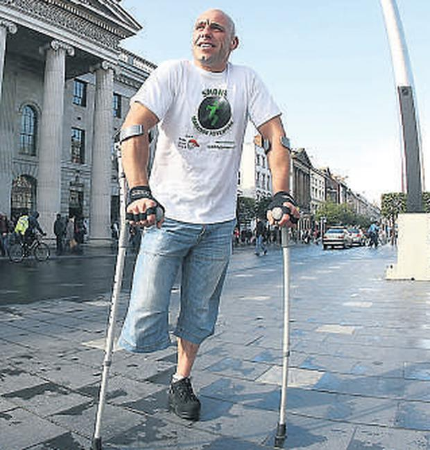 Limerick runner Simon Baker, 41, is aiming to set a world record for the fastest 26 miles on crutches when he competes in the Dublin city marathon on Monday