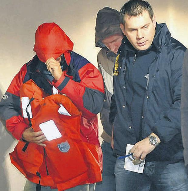 One of the suspects, still in his red sailing jacket and life vest, at Bantry garda station last night