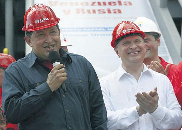 Venezuela President Hugo Chavez speaking as Russia Deputy Prime Minister Igor Sechin applauds during a visit to an exploration drill site in Punto Fijo in the Venezuelan state of Falcon last week