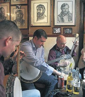 Musicians gather for a session at O'Donoghue's pub in Merrion Row - the home of traditional music in the capital