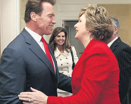 President Mary McAleese (right) meets California governor Arnold Schwarzenegger and his wife Marie Shriver at the Beverly Wilshire Hotel in Beverly Hills yesterday. Below, the president with actor Colin Farrell at Hollywood's Warner Brothers studios.
