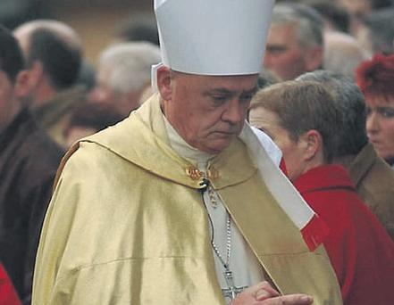Bishop John Magee at the funeral of slain schoolboy Robert Holohan in 2005.