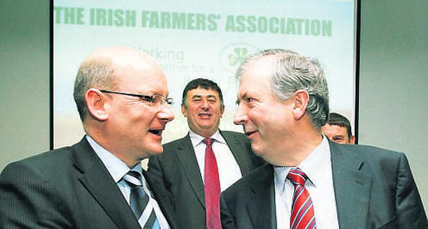 Incoming IFA general secretary Pat Smith is congratulated by outgoing general secretary Michael Berkery as IFA president Padraig Walshe looks on