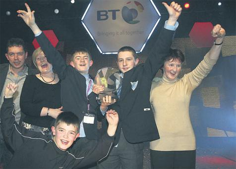 BT Young Scientists John D O'Callaghan, 14, and Liam McCarthy, 13, second year students from Kinsale Community School, Co Cork with their mothers, Anne McCarthy and Aisling O'Callaghan, and Tadhg McCarthy and Edward McCarthy