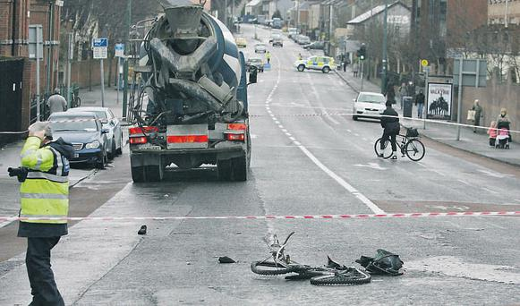 The cordoned-off scene at Harold's Cross Bridge in Dublin yesterday after a cyclist was killed following a collision with a cement truck