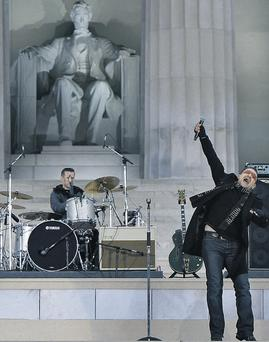 Bono performs with U2 at the Lincoln Memorial in Washington during the opening of festivities to mark the inauguration of Barack Obama as US president