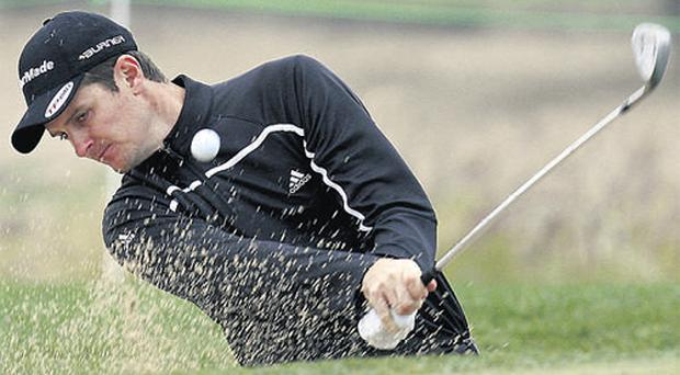 Justin Rose hits out of a bunker on the seventh hole during the Qatar Masters second round yesterday