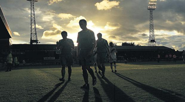 Drogheda United's players leave the pitch at Dalymount Park last season