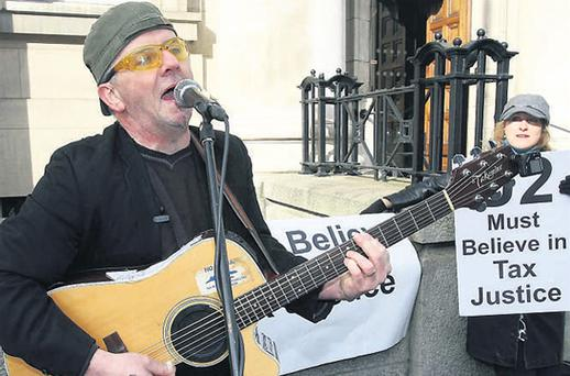 A Bono impersonator outside the Department of Finance in Dublin to highlight a campaign for 'global tax justice'. Campaigners claim millions of euros are lost from impoverished countries each year due to tax avoidance and tax evasion