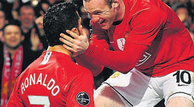 Cristiano Ronaldo celebrates with Wayne Rooney during his Manchester United days