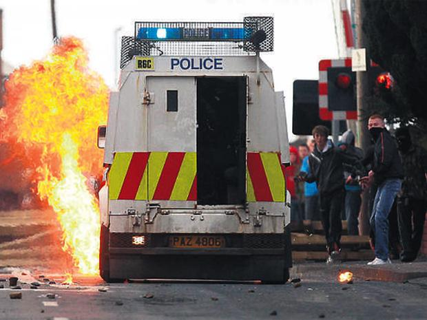 ARE WE BACK TO THE BAD OLD DAYS: Rioters set a PSNI van alight in Lurgan yesterday