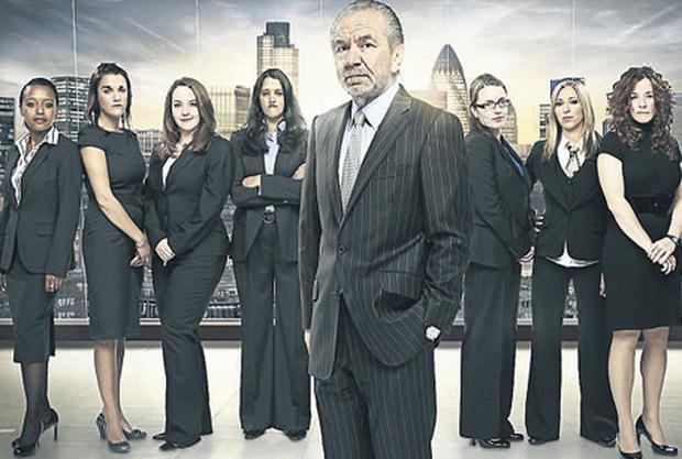 On top of his game: Boss Alan Sugar with the female contestants of this year's The Apprentice