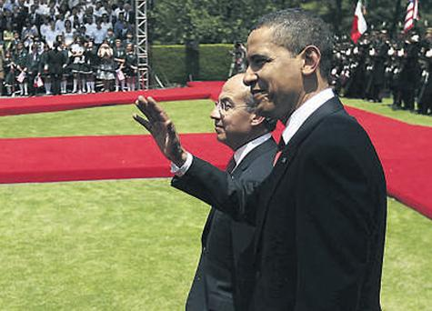 Mexico President Felipe Calderon and US President Barack Obama review an honour guard during an official welcoming ceremony at the presidential residence, Los Pinos, in Mexico City.