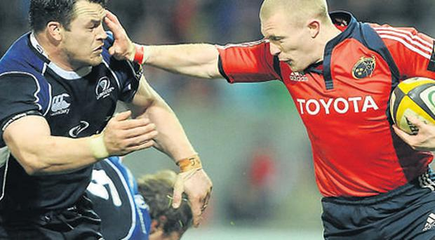 Keith Earls of Munster holds off Leinster's Cian Healy during the last meeting between the provinces earlier this month