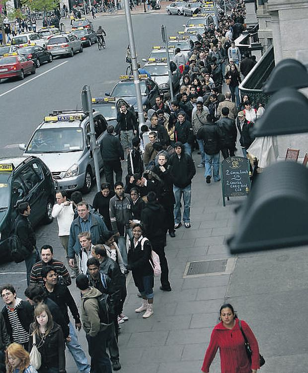 Crowds of people queue on at St Stephen's Green for 100 jobs available at Londis