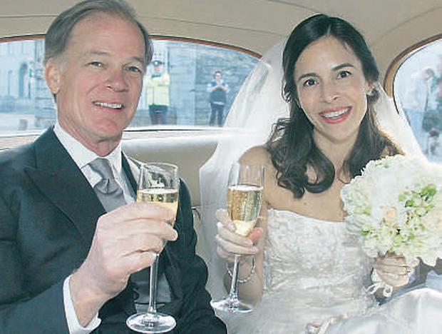 Tom Foley and his new bride Leslie Ann Fahrenkopf raise a toast to each other after the ceremony