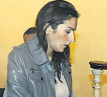 Anne-Laure Halimi, the victim's sister, enters court yesterday