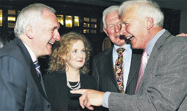 Former Taoiseach Bertie Ahern shares a joke with defeated by-election candidate Cllr Mary Fitzpatrick, his brother Cllr Maurice Ahern and Cllr Tom Stafford, who withdrew from the election during the Fianna Fail meeting at the Skylon Hotel in Dublin