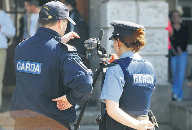 Gardai film those allegedly involved in the Dalton Park riots at Mullingar District Court yesterday