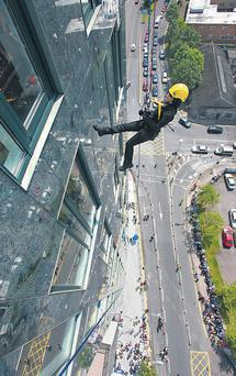 Ali Hewson is pictured abseiling from the Elysian Tower in Cork city in aid of the Chernobyl Children's Project