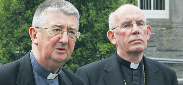 Dr Diarmuid Martin and Cardinal Sean Brady speaking to the media yesterday in Maynooth College