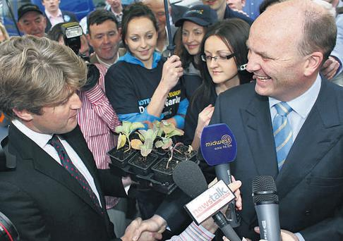 Independent candidate Michael McNamara presents Declan Ganley with cabbages with the suggestion that he take up farming after the Libertas leader failed to win a seat in the Ireland North West constituency