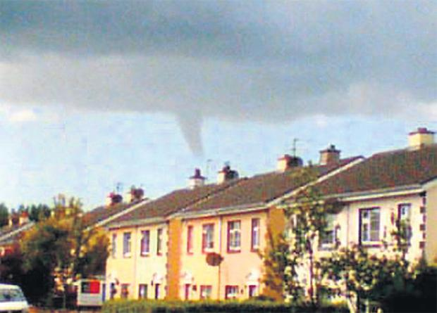 A mini tornado is captured on a camera phone in Ennis, Co Clare yesterday