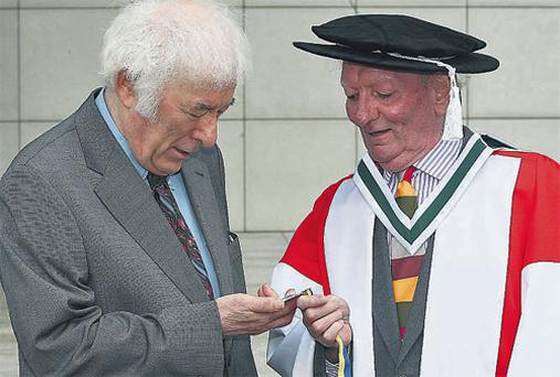 Brian Friel, pictured with Seamus Heaney, was awarded the Ulysses Medal by UCD