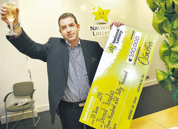 Dermot Finglas pictured with his €350,000 cheque at the National Lottery HQ yesterday