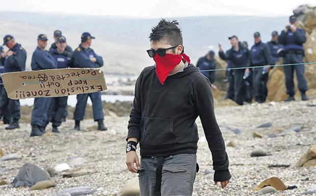 A Shell to Sea protester at Glengad, Co Mayo, where gardai created a perimeter around the beach yesterday