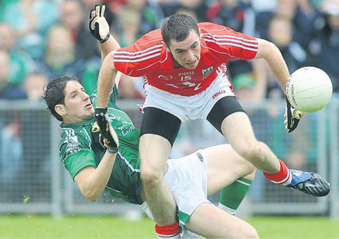 Limerick's Padraig Browne makes life tough for Donncha O'Connor at Pairc Ui Chaoimh