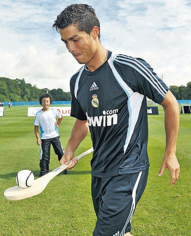 Ronaldo attempted to get to grips with a caman and sliotar during a special training session at Carton House in Kildare yesterday