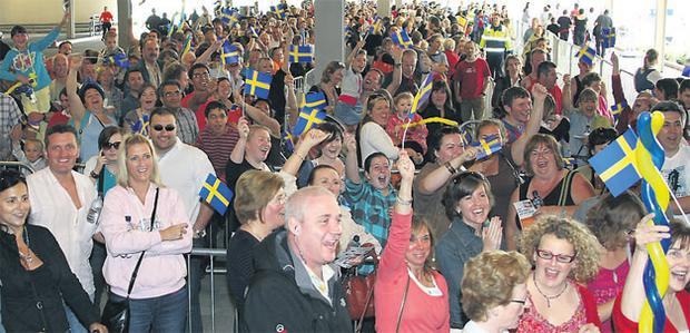 Shoppers enjoy a party atmosphere at the opening of the new IKEA store