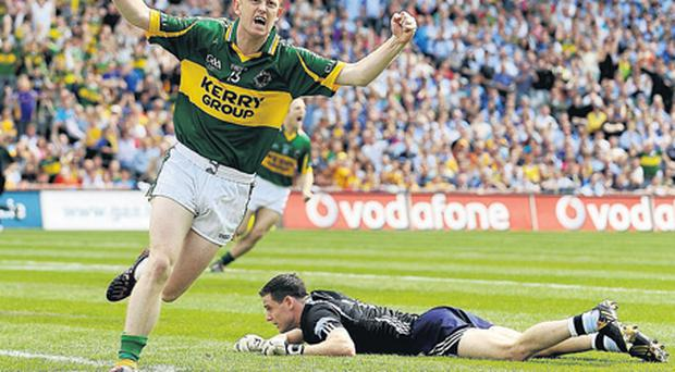 Colm Cooper celebrates his first-minute goal past a despondent Stephen Cluxton as both 'Gooch' and Kerry returned to form in Croke Park
