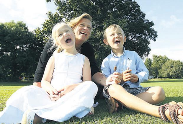 FBD group marketing manager Bronagh Twomey pictured with her four-year-old twins, Laura and Andrew