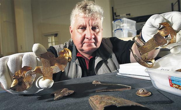 Terry Herbert with some of the 1,500 pieces which made up the Anglo-Saxon treasure hoard he found in a field with his trusty 14-year-old detector
