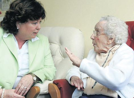 Health Minister Mary Harney was greeted by 104-year-old May Hackett at the opening of a new private care home in Dublin