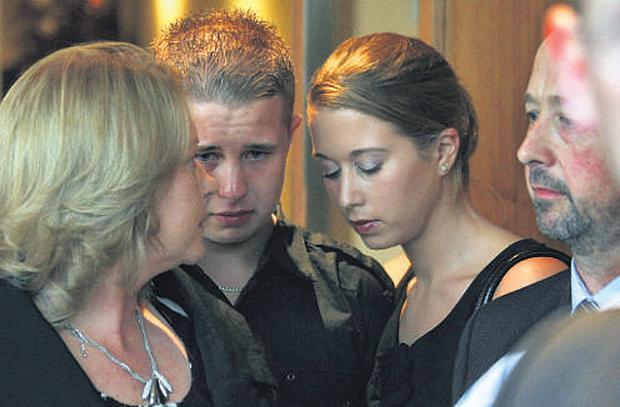 Emmet Dwyer, brother of Michael, is consoled by his sister, Aisling, and parents, Martin Dwyer Snr (right) and Caroline (left) after the inquest into the death of Michael Dwyer yesterday