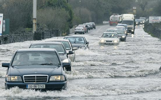 Motorists take their chances by trying to get through the flooded Tuam Road at Two-Mile Ditch in Co Galway