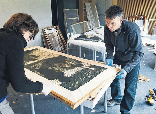 Paul Curtis, conservator in Muckross House, and Emer Towmey, UCC archivist, attempt to salvage artwork in the Glucksman Art Gallery in UCC