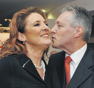 Iris and Peter Robinson kiss at the DUP conference last month