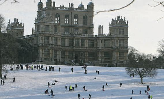Sledging in Wollaton Park, Nottingham, as the cold snap continues yesterday