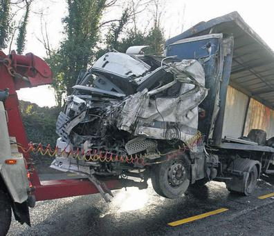 The wrecked truck is towed away after it turned over on the N18 Galway to Ennis road, just inside the Co Clare border