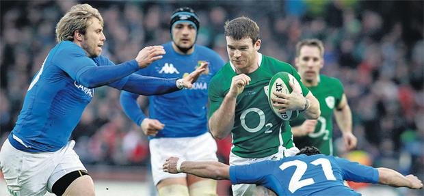Gordon D'Arcy looks to break the tackles of Craig Gower and Riccardo Bocchino