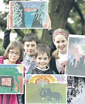 Katherina Gannon, Anthony McGuinness, John Ahearne and Niamh Kavanagh with their winning paintings at Airfield House, in Dundrum, yesterday